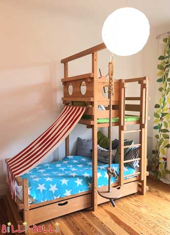 "The Pitched Roof Bed, here in beech. The Wiesenhütter family writes: Although we don't have a sloped ceiling, our son wished for this bed. He likes to make himself comfortable in the bottom area ""like in a cave"" and to spend time in his observation tower, where he plays or reads."