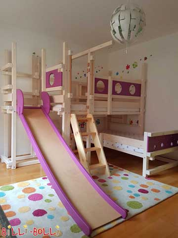 Upon customer's request, the swing beam of this Corner Bunk Bed was moved to the left by a quarter of a bed length. The upper sleeping level has been assembled at height 4. A slide tower has been attached to the bed, which reduces the room depth needed for a slide. Purple highlights have been added to the porthole and mouse boards as well as the slide.