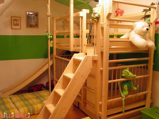 Bunk bed with slide tower and slide, baby gates, inclined ladder and wall bars (mounted to the short side of the bed). The play floor in the upper level is especially handy for the polar bear.