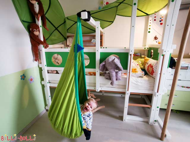 The Loft Bed Adjustable by Age as jungle bed. Pictured here in white varnish and equipped with the fireman's pole, hanging cave as well as porthole theme boards.