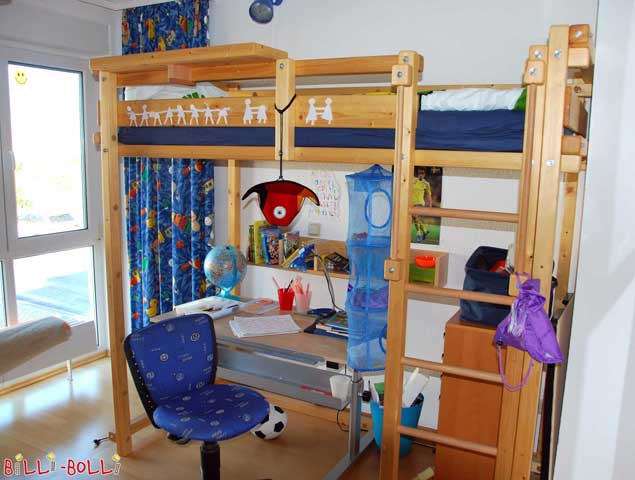 The Youth Loft Bed equipped with a bedside table at the top.