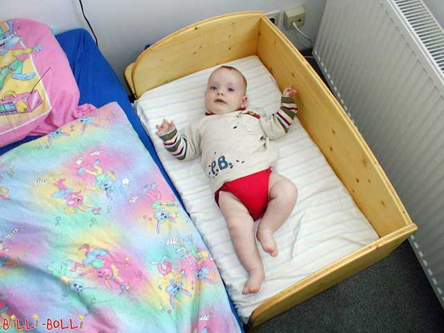 Dear Billi-Bolli team! I'd like to leave you all a short review since I am so satisfied with your bedside crib: Our son Valentin was born on 8th January. Since then he has been sleeping in his Billi-Bolli bed and is obviously very content. For us, it was surely a very good decision to purchase this bed because nights have been so stress-free. When I want to feed our Valentin, I simply bring his bed closer to me. And if I fall asleep, there is no danger that he will fall out of his bed; he can simply roll back into his crib. In addition, he is very seldom fully awake during nursing nowadays. This is great for my husband as well, and he hardly notices that I'm breastfeeding Valentin. The nights surely wouldn't be as refreshing if we had opted for a standard crib instead (which, of course, would have included waking up, getting out of bed, taking him out of the crib, screaming, …). Thanks for this great idea! Judith Fillafer-Schuh
