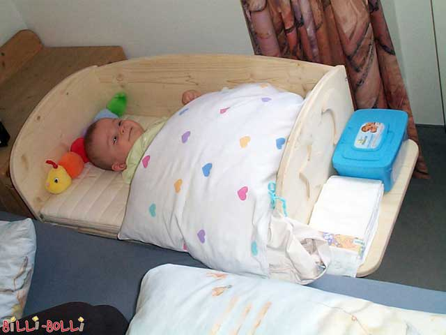 The bedside crib will help you in the first few months to have more restful and comfortable nights. Your baby is close to you and you do not have to get up for feeding. And you are close to your baby. Good for both, mama and child. There is a simplified assembly manual available as a free PDF download for the ambitious handyman, including telephone support if needed: Bedside Crib Construction Manual