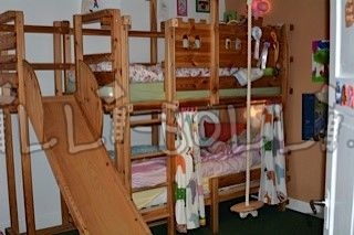High bed with 2 beds, slide tower and plate swing (second hand loft bed)